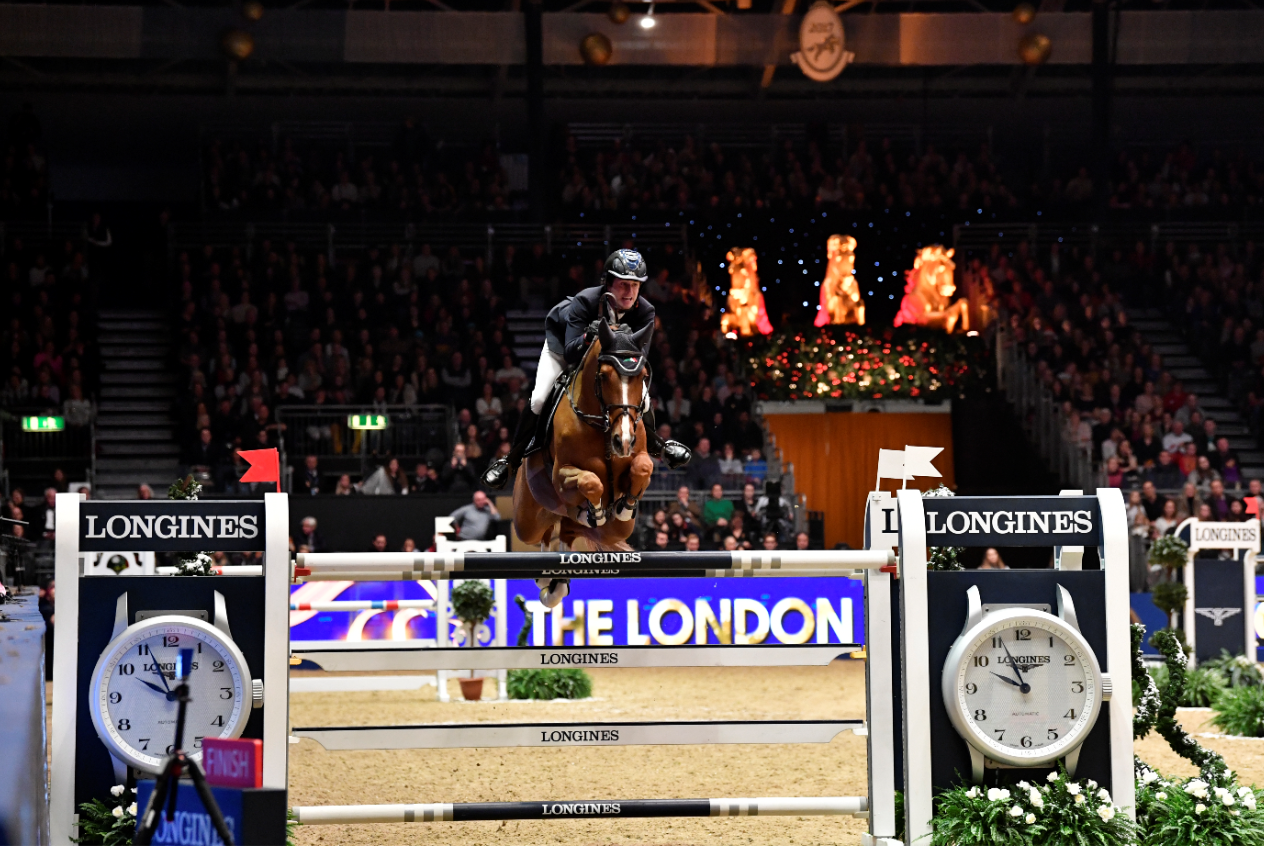FULL SPEED AHEAD ON RACE NIGHT AT OLYMPIA, THE LONDON INTERNATIONAL HORSE SHOW